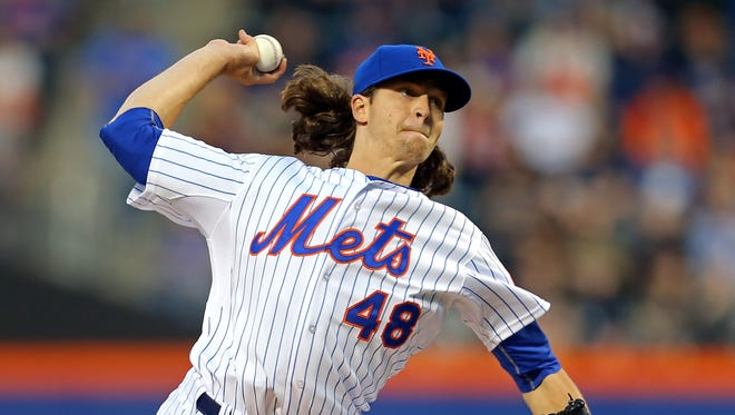 Mets starting pitcher Jacob deGrom pitches against the Marlins during the first inning at Citi Field.