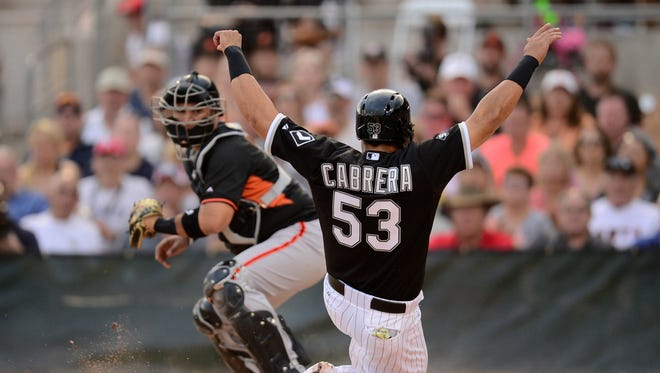 The Chicago White Sox and Los Angeles Dodgers share Camelback Ranch Glendale, the largest complex in the Cactus League. Pictured is White Sox outfielder Melky Cabrera sliding home safely to score a run against the San Francisco Giants on March 12, 2015 at the complex.