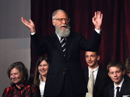 David Letterman waves during the show at the 20th Annual