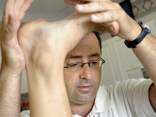 Dr. Larry Nassar works with a patient in this 2008