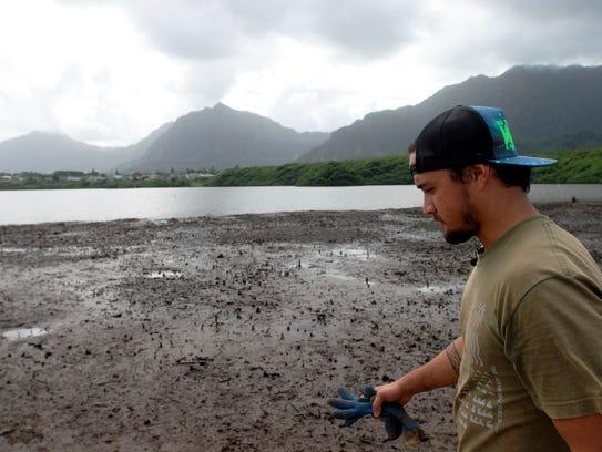 Conservation International's Luka Mossman walks near