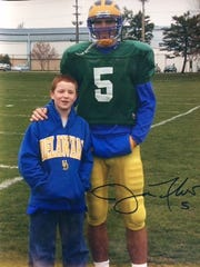 Pat Crowley, then age 10, and Joe Flacco after a Delaware