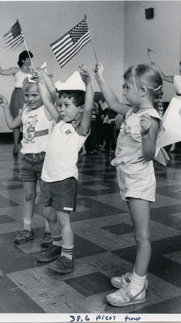 Children wave flags.