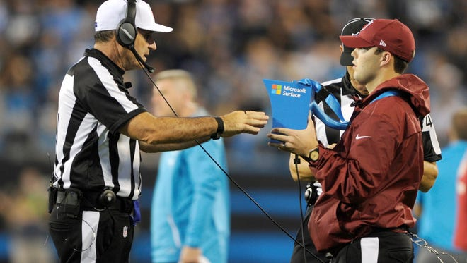 Referee Pete Morelli watches a replay in the second half of an NFL football game between the Carolina Panthers and the Philadelphia Eagles in Charlotte, N.C., Thursday, Oct. 12, 2017. (AP Photo/Mike McCarn)