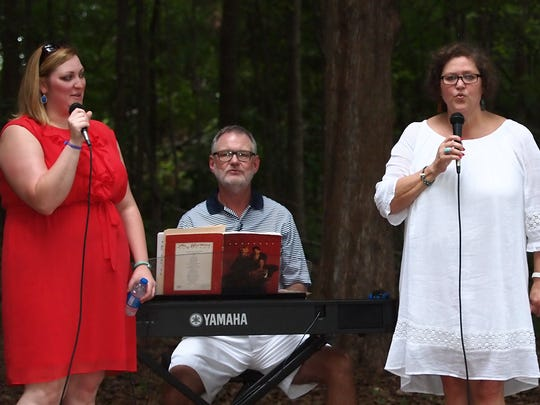 Caroline, father Perry, mother Helen and Jacob Hamilton sing for the outdoor service Sunday evening at Aldersgate United Methodist United Church.