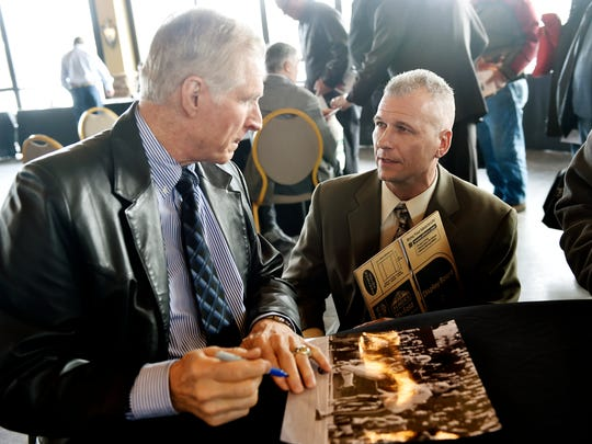 Dallas Cowboys Hall of Famer Bob Lilly, left, speaks with Paul Kosiek of Montgomery County as he signs a photograph during the 52nd annual York Area Sports Night Thursday, Feb. 11, 2016, at Heritage Hills.