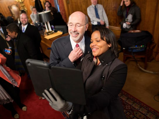 Gov. Tom Wolf takes a selfie with Sincere Harris in the governor's reception room Jan. 20, 2015, after he took his oath of office  at the state Capitol in Harrisburg, Pa., to become the state's 47th governor.