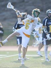Morris Knolls boys lacrosse vs. Vernon at Morris Knolls High School on Wednesday, April 11, 2018. MK #5 Parker Campbell takes a shot in the fourth quarter.