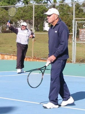 """Longtime University of West Florida tennis coach Ralph """"Skeeter"""" Carson (front) plays tennis with friend Sam Stevenson during an undated match at Bayview Park."""