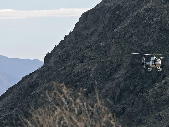 A search-and-rescue helicopter returns to the Palm Springs Aerial Tramway after they rescued a hiker who had been lost for a day in February 2008.