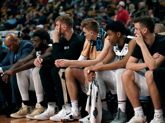 Purdue players sit on the bench near the end of an NCAA men's college basketball tournament regional semifinal against Texas Tech, early Saturday, March 24, 2018, in Boston. (AP Photo/Charles Krupa)