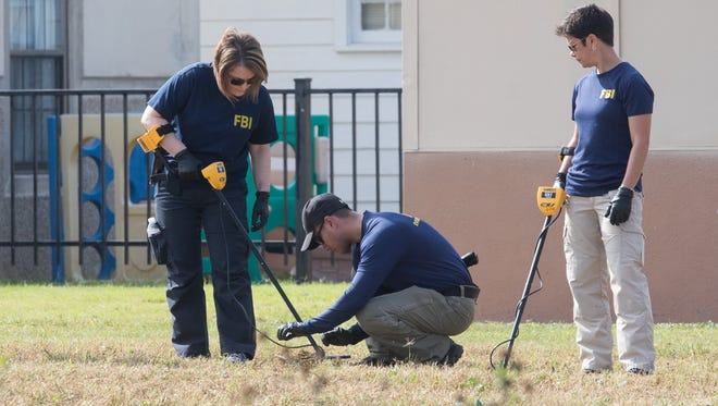 Members of the FBI look for evidence in the field next to the First Baptist Church in Sutherland Springs, Texas on Nov. 6, 2017.