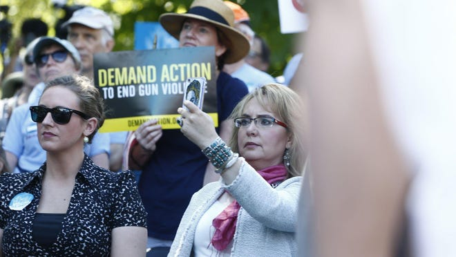 Gabby Giffords urges officials, families who lost loved ones to gun violence and others to act on laws for tighter controls on gun sales.