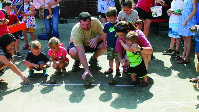 The annual Magazine homecoming event has been moved to Oct. 16 and 17, coinciding with the school's football homecoming game weekend. Above, even parents get into the tutle races during the 2019 event.