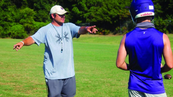 Booneville first year head coach Doc Crowely states the expectations for a particular play during a practice Monday morning.