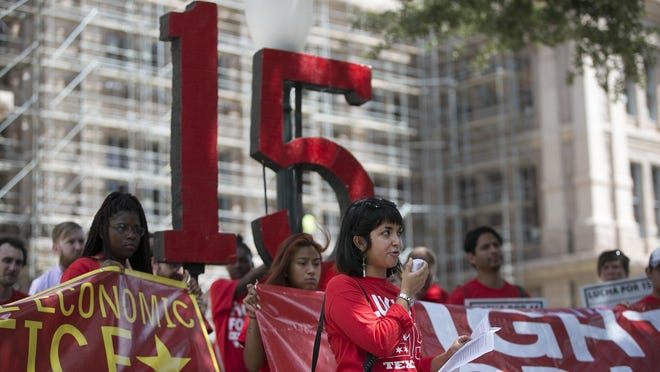 Andrea Flores speaks at a rally in support of a $15 minimum wage at the Capitol following a march from Austin City Hall in  2016.