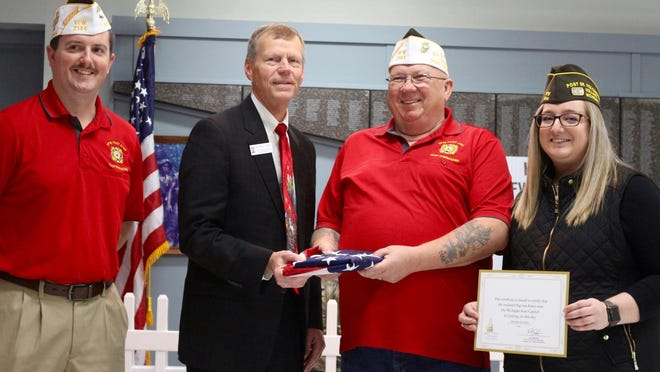 State Rep. Bradley Slagh presents VFW Post 2144 with an American Flag in recognition of Veterans Day in Nov. 2019.