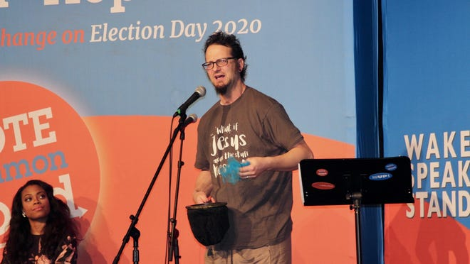 Shane Claiborne speaks during the Vote Common Good rally at the Park Theatre in Holland on Wednesday, Feb. 5.