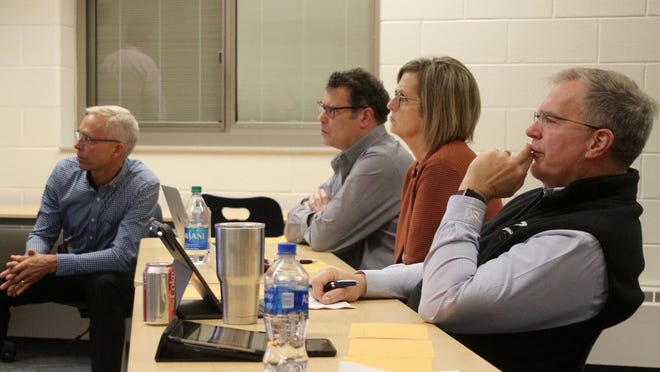 Members of the Zeeland Public Schools Board of Education listen during a work session in December 2019.