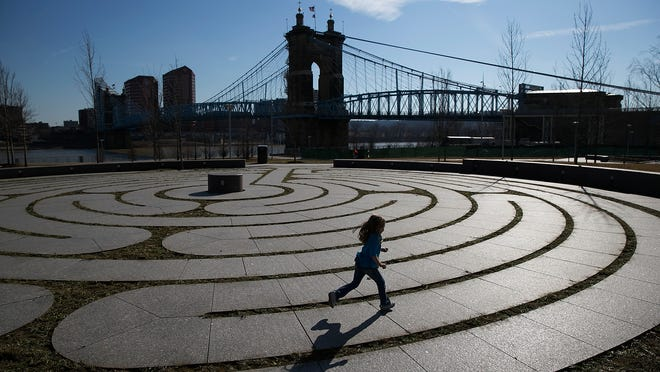 Tuesday, March 11, 2014 FEATURE METRO : Abigail Lang, 5 of downtown takes advantage of the warm weather and runs the labyrinth at the Smale Riverfront Park. The Enquirer/Jeff Swinger