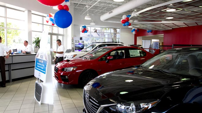 Mazda and Suburu vehicles line the showroom in the old Mazda dealership Wednesday on Colonial Blvd. in Fort Myers, recently purchased by the O'Brien dealership.