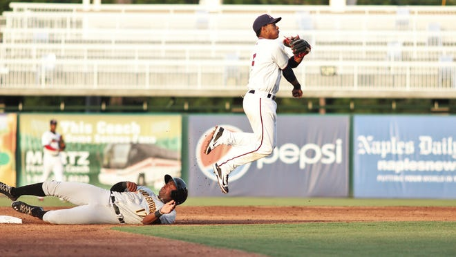 Fort Myers Miracle shortstop Jorge Polanco jumps over Bradenton's Josh Bell and attempts to complete a double play Tuesday at Hammond Stadium.