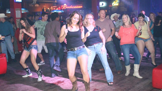 Line dance lessons at Dixie Roadhouse.