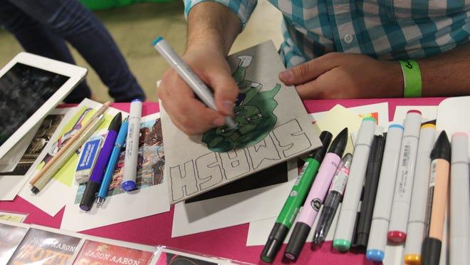 Rico Renzi of Marvel Comics created original art for a fan at last year's SC Comicon.