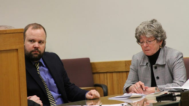 Joshua Burns, left, talks with one of his attorneys at his sentencing hearing in Livingston County Circuit Court in March.
