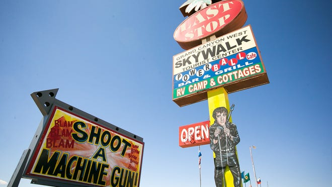 Signs advertising the shooting range at Bullets and Burgers in White Hills, Az., Wednesday, August 27, 2014.