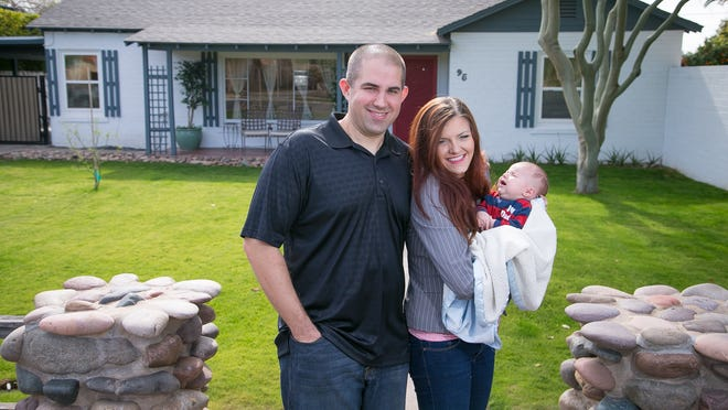 Chase Dubs and his girlfriend Anna Monroe (holding their 2-month-old son, Austin Dubs) are trying to draw Super Bowl visitors to their Phoenix rental property, as well as their private residence, during Super Bowl week.