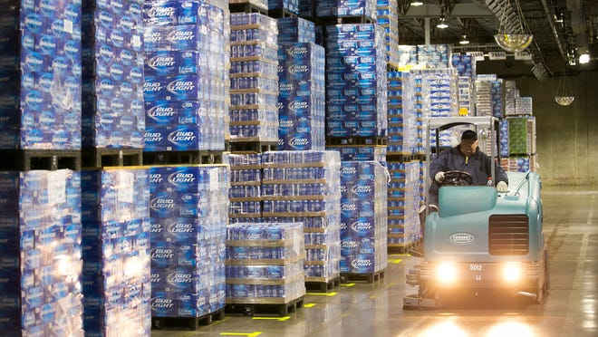 Tim Housel works the stacks of Anheuser-Busch products at the Hensley Beverage Co. warehouse in west Phoenix this month. The company, the sole Anheuser-Busch distributor in the Valley, has diversified into other product lines, including wine and craft beer.