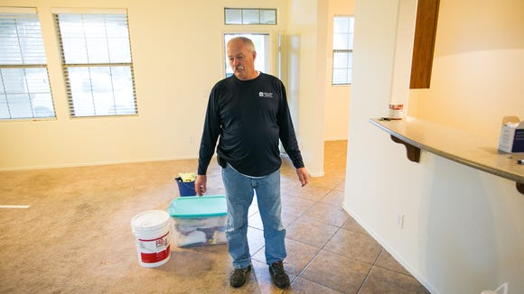 Bruce White, with Save the Family, stands in an affordable rental home that they just had painted in Gilbert on Friday, January 30, 2015.