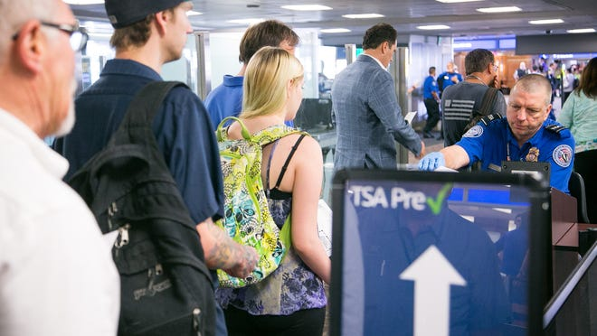 A line forms at Phoenix Sky Harbor International Airport's Terminal 4 as passengers have their boarding passes and IDs checked by TSA. Arizona's driver's licenses aren't Real ID compliant which means, beginning in 2016, they won't be accepted by airport security.