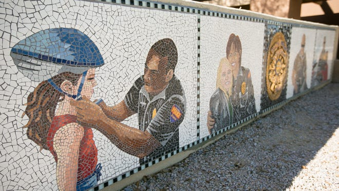 """The """"Partners"""" art mosaic at an Avondale Police substation in downtown Avondale."""