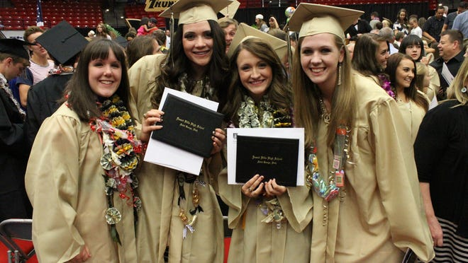(From left) Maddi Jones, Haley Bodnar, Cassidie Clayton and Emily Seifert pose for an uncool dad as he takes their photo after commencement for Desert Hills High School.