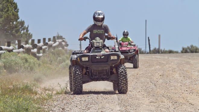 Cedar City residents Kyler Bergener and his friend Bridger Cox ride through Three Peaks Recreational Park.