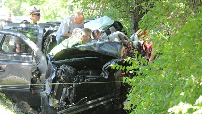 Damage is shown to Louis Freeh's gray 2010 GMC Yukon.