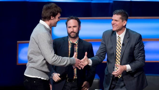 """Jim Harbaugh greets Tom Brady at the """"Signing of the Stars"""" event in Ann Arbor."""