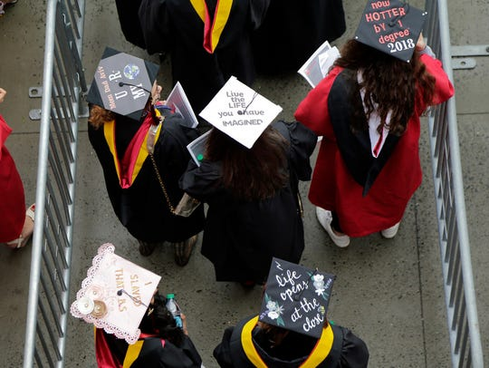 Rutgers University students walk into their graduation