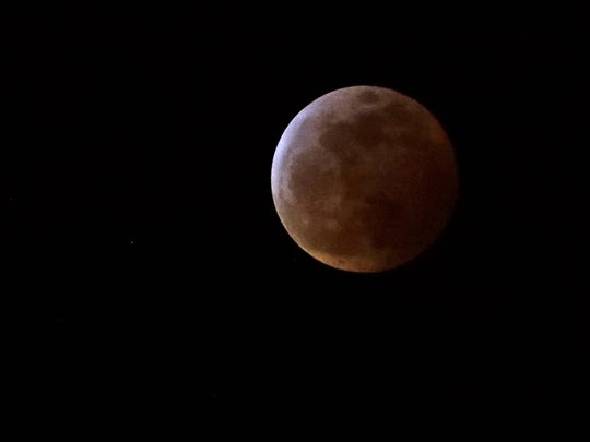 The Super Blood Wolf Moon eclipse is seen Monday, Jan. 21, 2019, in Valrico, Fla.