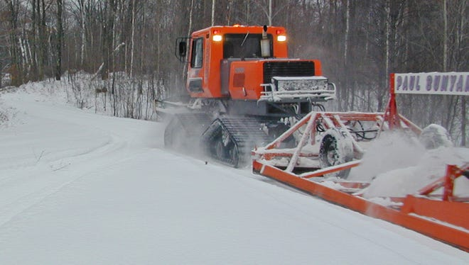 A snowmobile trail groomer in Oconto County.