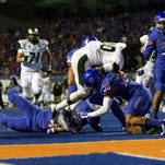 CSU running back Dee Hart is stopped short of the goal-line by cornerback Jonathan Moxey and other Boise State defenders during the Broncos' 37-24 win over the Rams on Sept. 6. CSU has won nine straight games since that loss but can't get to the conference's championship game because of it, unless the Broncos lose Saturday night to Utah State.