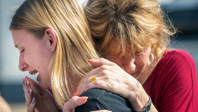 Santa Fe High School student Dakota Shrader is comforted by her mother Susan Davidson following a shooting at the school on Friday, May 18, 2018, in Santa Fe, Texas.