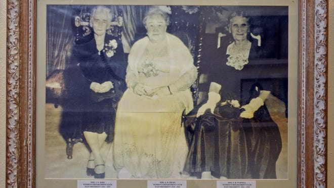 A photograph of the original Women's Department Club founders, Mrs. J.P. Hird (left), Mrs. S.B. Hicks, and Mrs. S.B. Purnell, hangs in the hallway by the club's offices.