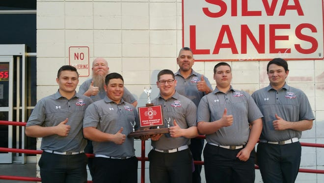 The Deming High Wildcat Bowling Team captured a second place trophy at the New Mexico High School State Bowling Tournament  on feb. 25, in Albuquerque. The team consists of, from left, Jared Morgan, assistant coach Sonny Garney, Sabastian Camacho, Mando Perales, head coach Richard Perales, Ryan Gigante and Ronnie Simmons.