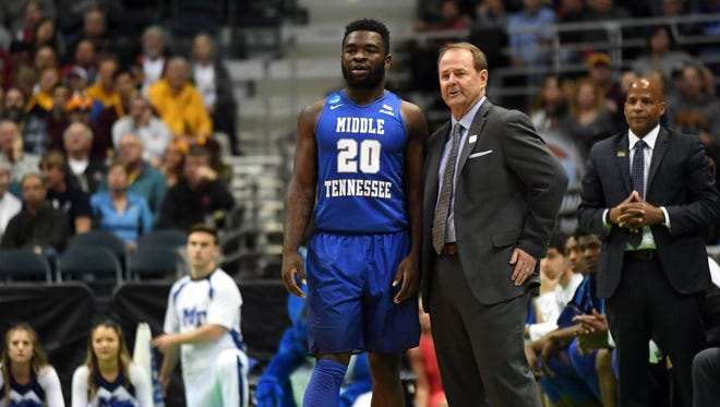 Middle Tennessee Blue Raiders guard Giddy Potts (20) and head coach Kermit Davis talk during the second half of the game in the first round of the NCAA tournament at BMO Harris Bradley Center.