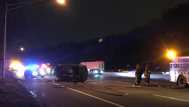 An overturned vehicle closed lanes on Route 80 in Paterson Jan. 29, 2018.