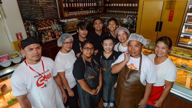 The Cafe Panadero and New Fresh Bread Bakeshop staff are shown at Cafe Panadero in Yigo in this Feb. 25 file photo.
