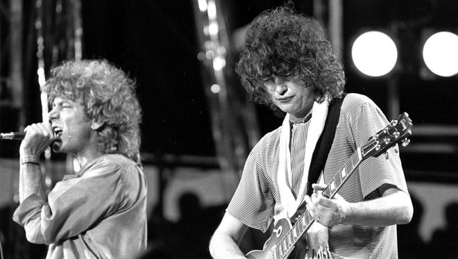 """In this July 13, 1985 file photo, singer Robert Plant, left, and guitarist Jimmy Page of the British rock band Led Zeppelin perform at the Live Aid concert at Philadelphia's J.F.K. Stadium. Generations of aspiring guitarists have tried to copy the riff from Led Zeppelin's """"Stairway to Heaven."""" Starting Tuesday, June 14, 2016, a Los Angeles court will try to decide whether the members of Led Zeppelin themselves ripped off that riff. Page and Plant are named as defendants in the lawsuit brought by the trustee of late guitarist Randy Wolfe from the band Spirit."""